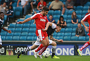 Chesterfield player Sam Morsy tussles with Millwall player Sid Nelson during the Sky Bet League 1 match between Millwall and Chesterfield at The Den, London, England on 29 August 2015. Photo by Bennett Dean.