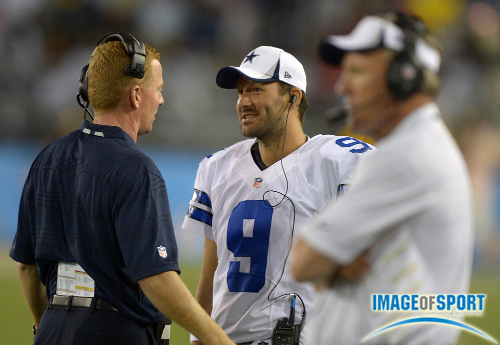 Aug 4, 2013; Canton, OH, USA; Dallas Cowboys coach Jason Garrett (left), quarterback Tony Romo (9) and quarterbacks coach Wade Wilson (right) during the 2013 Hall of Fame Game against the Miami Dolphins at Fawcett Stadium. The Cowboys defeated the Dolphins 24-20.