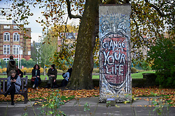 © Licensed to London News Pictures. 05/11/2019. LONDON, UK. Work by East German street artist INDIANO outside the Imperial War Musuem stands opposite the unveiling of new work by artists Theirry Noir and STIK on original Berlin Wall sections to mark 30 years since the fall of the Berlin Wall.  Located outside the Imperial War Museum, the new works reflect the symbolic connections between the Berlin Wall and street art and the fall of the wall on 9 November 1989.  These new works are on display until 1 December.  Photo credit: Stephen Chung/LNP