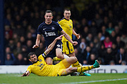 John Mousinho of Oxford United sliding tackle on Tom Hopper of Southend United during the EFL Sky Bet League 1 match between Southend United and Oxford United at Roots Hall, Southend, England on 6 October 2018.