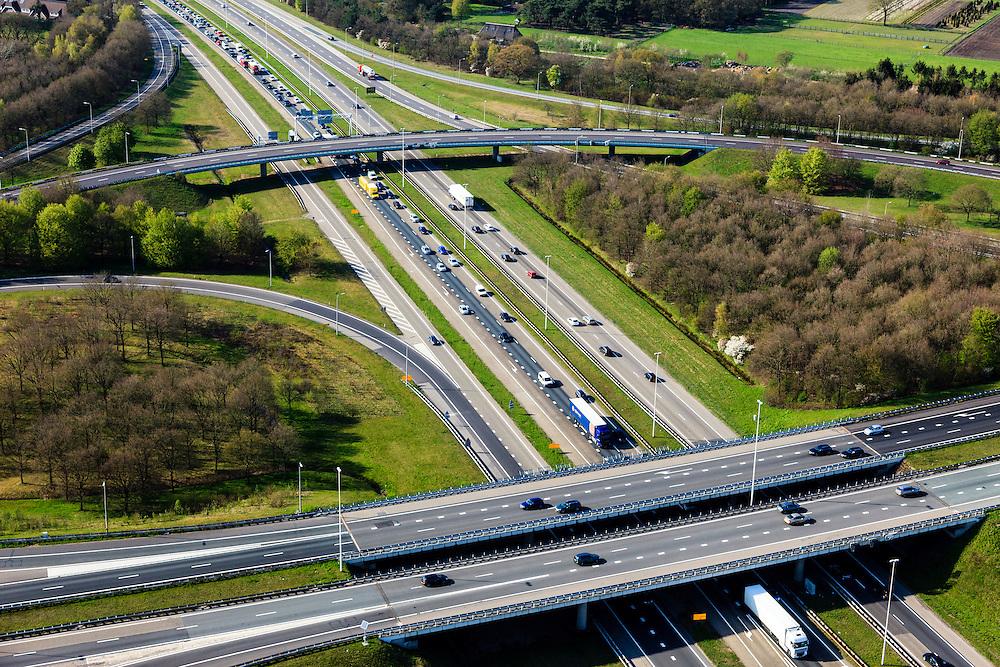 Nederland, Utrecht, Gemeente Eemnes, 01-05-2013; ontstaan van file op knooppunt Eemnes, kruising A1 (Amsterdam - Amersfoort) en A27 (Hilversum-Almere)<br /> File richting Amersfoort (onder in beeld).<br /> Development of a traffic jam on Junction Eemnes, A27/A1 (central Netherlands)<br /> luchtfoto (toeslag op standard tarieven)<br /> aerial photo (additional fee required)<br /> copyright foto/photo Siebe Swart