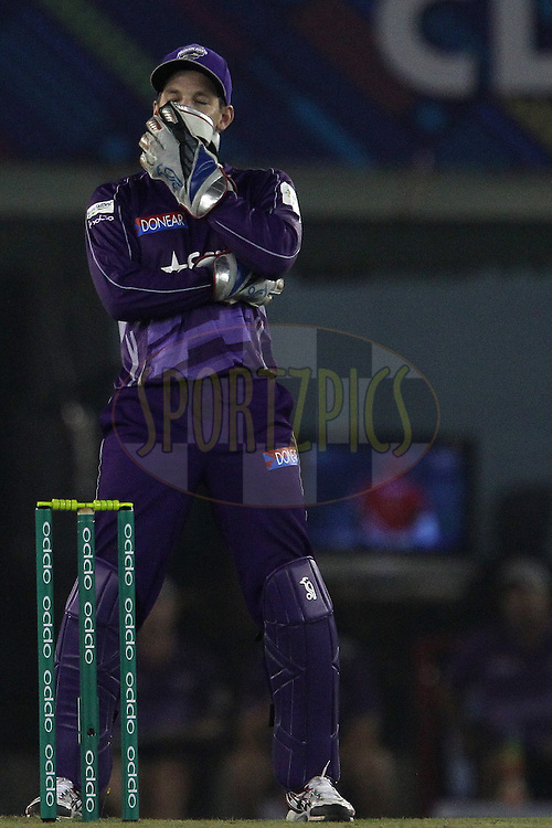 Tim PAINE (Captain) of the Hobart Hurricanes  reacts after a delivery during match 2 of the Oppo Champions League Twenty20 between the Kings XI Punjab and the Hobart Hurricanes held at the Punjab Cricket Association Stadium, Mohali, India on the 18th September 2014<br /> <br /> Photo by:  Ron Gaunt / Sportzpics/ CLT20<br /> <br /> <br /> Image use is subject to the terms and conditions as laid out by the BCCI/ CLT20.  The terms and conditions can be downloaded here:<br /> <br /> http://sportzpics.photoshelter.com/gallery/CLT20-Image-Terms-and-Conditions-2014/G0000IfNJn535VPU/C0000QhhKadWcjYs