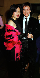 Leading London social figures MR & MRS ANDY WONG, at a party in London on 27th September 1999.MWU 10