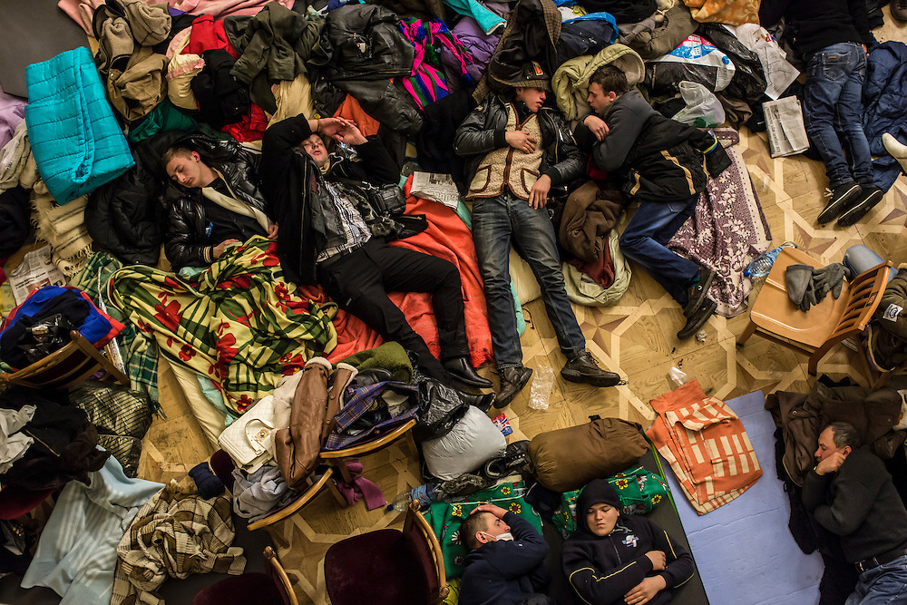 KIEV, UKRAINE - DECEMBER 7: Anti-government protesters sleep on the floor of the occupied Kiev City Hall on December 7, 2013 in Kiev, Ukraine. (Photo by Brendan Hoffman/Getty Images)