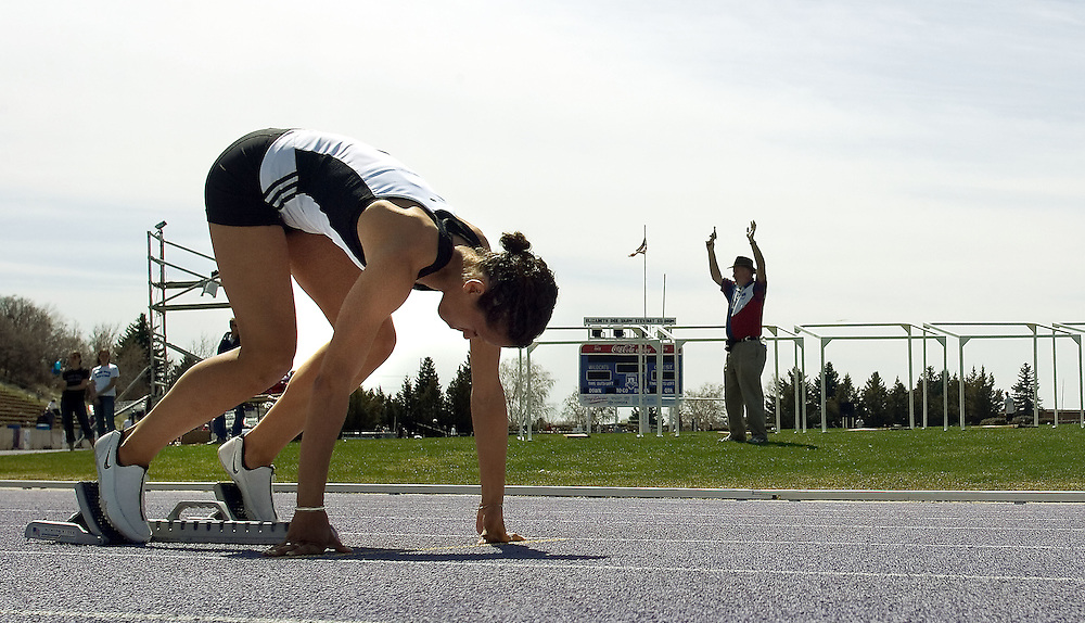 Tracee Jones of SUU competes in the 4 X 100 meter relay and the 400 meter sprint coming in 1st in the 400 meter with a time of 55.61 seconds during a track meet at Weber State University in Ogden, Utah Saturday April 8, 2006. August Miller