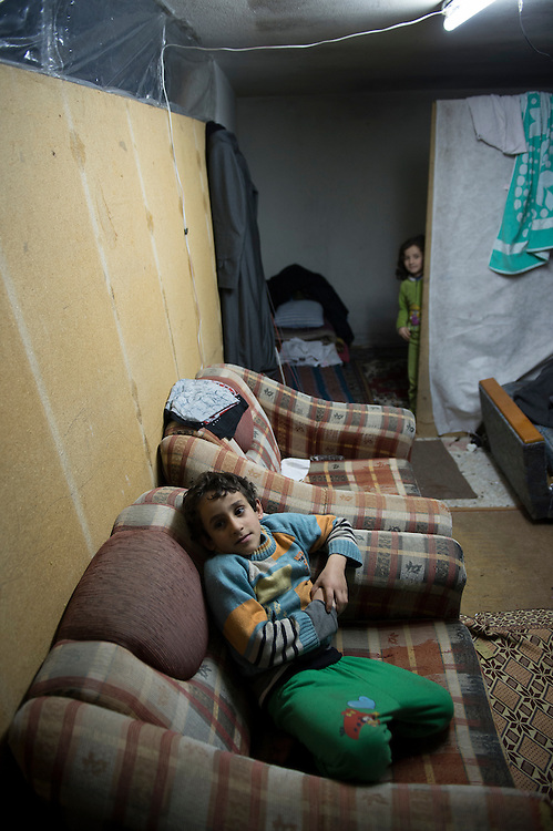 Mohammed 7 years, in the district Korshiyaka Muhales in Gaziantep (Turkey), the family lives since 7 month  in a cellar, with no windows, they pay 100 dollar / month to the owner but they must evacuate the place in 3 days. Children did not go to school since 3 years.