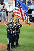 LOS ANGELES, CA - MAY 25:  Flags fly as the color guard performs during the National Anthem at the Los Angeles Dodgers game against the St. Louis Cardinals at Dodger Stadium in Los Angeles, California on May 25, 2008. The Dodgers defeated the Cardinals 4-3 in ten innings. ©Paul Anthony Spinelli