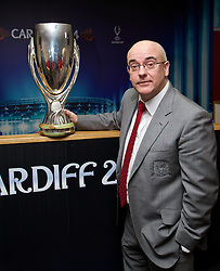 +++ FREE USE FOR STORIES PROMOTING THE UEFA SUPER CUP 2014 ONLY +++<br /> <br /> CARDIFF, WALES - Monday, February 17, 2014: FAW press officer Ceri Stennett with the UEFA Super Cup trophy on display at the Cardiff City Stadium where the game will be played on 12th August. (Pic by David Rawcliffe/Propaganda)