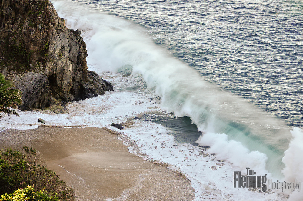 Waves crashing on a private beach, looking down from cliffs above San Pancho, Mexico