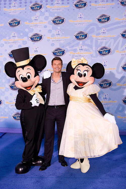 LAKE BUENA VISTA, FL - FEBRUARY 12: American Idol host Ryan Seacrest walks on the red carpet for the grand opening of the American Idol Experience at Disney's Hollywood Studios In Walt Disney World on February 12, 2009 in Lake Buena Vista, Florida. (Photo by Matt Stroshane/Getty Images)