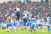 Bolton Wanderers defender Liam Edwards in areal challengeduring the EFL Sky Bet League 1 match between Bolton Wanderers and Coventry City at the University of  Bolton Stadium, Bolton, England on 10 August 2019.