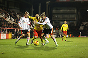 Adlene Guedioura battling with Konstantinos Stafylidis during the Sky Bet Championship match between Fulham and Watford at Craven Cottage, London, England on 5 December 2014.