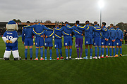 AFC Wimbledon with arms linked for minutes silence during the The FA Cup match between AFC Wimbledon and Doncaster Rovers at the Cherry Red Records Stadium, Kingston, England on 9 November 2019.