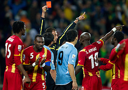 Referee Olegario Benquerenca with Red card  for Luis Suarez of Uruguay who saved a goal with a hand during the overtime at 2010 FIFA World Cup South Africa Quarter Finals football match between Uruguay and Ghana on July 02, 2010 at Soccer City Stadium in Sowetto, suburb of Johannesburg. Uruguay defeated Ghana after penalty shots. (Photo by Vid Ponikvar / Sportida)
