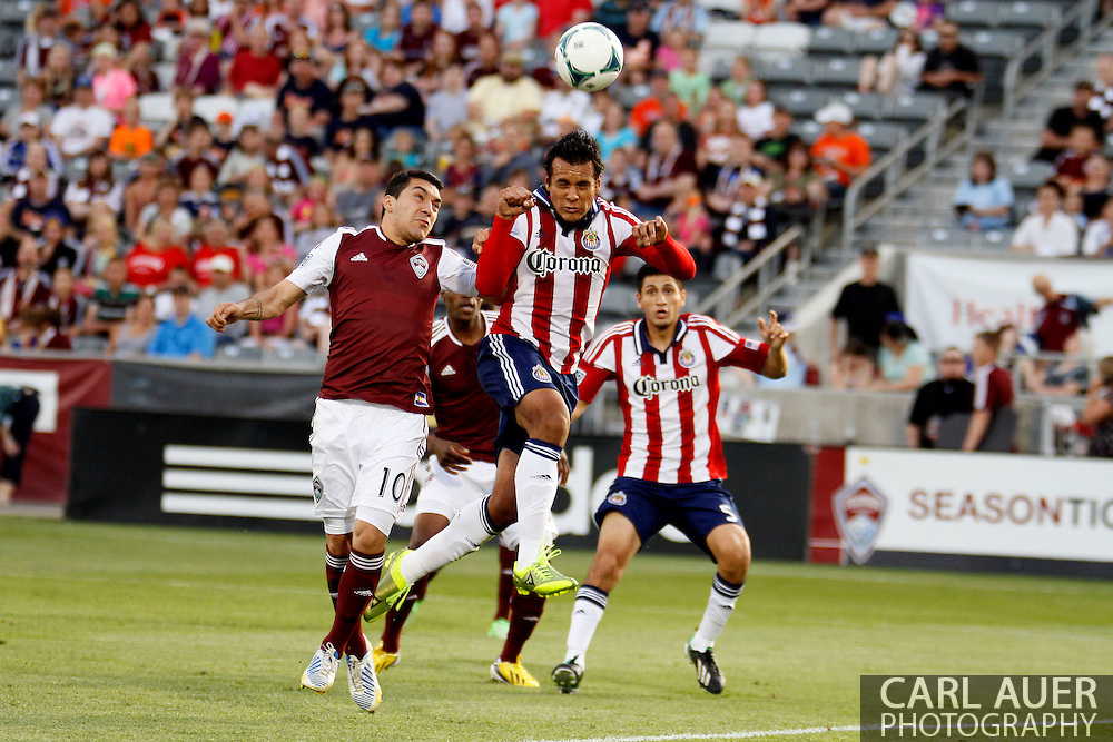 May 25th, 2013 Commerce City, CO - Chivas USA defender Mario de Luna (3) heads the ball away from his goal to thwart a Colorado scoring attempt in the first half of the MLS match between Chivas USA and the Colorado Rapids at Dick's Sporting Goods Park in Commerce City, CO