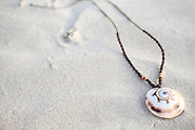 Seashell necklace on the sand