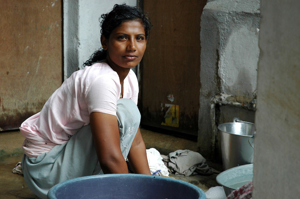 A Maldhari woman does laundry after her family moved to the city...by Michael Benanav - mbenanav@gmail.com
