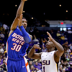 December 10, 2011; Baton Rouge, LA; Boise State Broncos guard Westly Perryman (30) passes as LSU Tigers guard Anthony Hickey (1) defends during the second half of a game at the Pete Maravich Assembly Center. LSU defeated Bosie State 64-45. Mandatory Credit: Derick E. Hingle-US PRESSWIRE