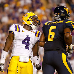 Sep 25, 2010; Baton Rouge, LA, USA; LSU Tigers cornerback Jai Eugene (4) taunts West Virginia Mountaineers tight end Will Johnson (6) during the first half at Tiger Stadium.  Mandatory Credit: Derick E. Hingle