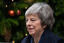 © Licensed to London News Pictures. 12/12/2018. London, UK. British Prime Minister Theresa May leaves 10 Downing Street to attend Prime Minister's Questions in the Houses of Parliament, after announcing this morning that she will contest tonight's vote of no confidence in her leadership. Overnight, 48 letters were handed in triggering the vote of no confidence. Photo credit : Tom Nicholson/LNP