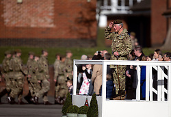 The Prince of Wales, Colonel Welsh Guards, takes the salute as he attends Elizabeth Barracks in Woking to present campaign medals to soldiers from the 1st Battalion Welsh Guards following their return from Afghanistan.