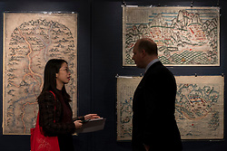 "© Licensed to London News Pictures. 03/11/2016. London, UK. Rare maps of ancient China are shown at the preview of Chinese artworks entitled ""Treasures Of The Song & Qing Dynasties"" to be auctioned at Sotheby's in November.   Photo credit : Stephen Chung/LNP"