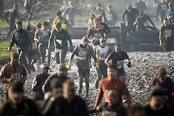 """©  London News Pictures. 27/01/2013.  Competitors being  pushed to the limits as they compete in the 2013 Tough Guy Challenge on January 27, 2013 in Wolverhampton, England. The event has been widely described as """"the toughest race in the world"""", with over one-third of the starters failing to finish in a typical year. Photo credit: Ben Cawthra"""