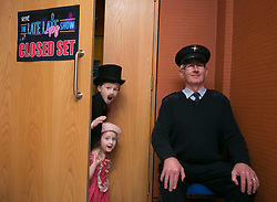 Repro Free: 28 November 2013<br /> THIS YEARS LATE LATE TOY SHOW PROMISES TO BE SUPERCALIFRAGILILSTICEXPIALIDOCIOUS&hellip;. <br /> RTE Security Guard Tom Clarke guards the secret set of this year&rsquo;s Late Late Toy with Sam Kirwan (8) Navan and Emily Talbot (5) from Navan and it promises to be supercalifragililsticexpialidocious! The theme of this year&rsquo;s show is based on the much loved musical film Mary Poppins. Picture Andres Poveda