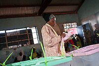 A woman votes in the morning at Old Kibera Primary School Polling Station, where Presidential candidate Raila Odinga also cast his vote.
