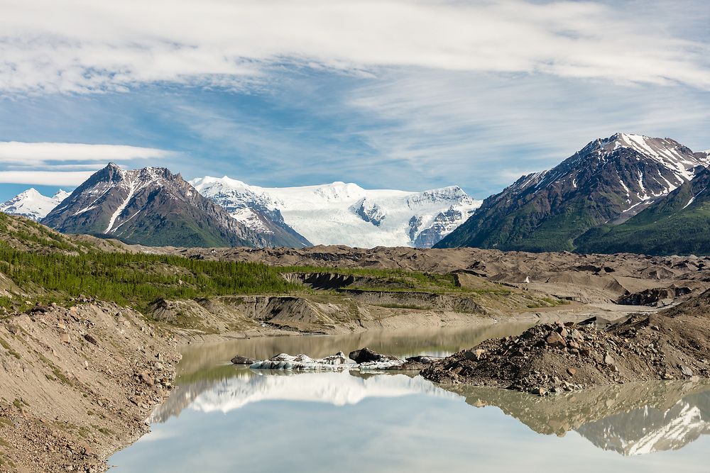 Melt water and ice at the terminus of the Kennicott and Root Glaciers near McCarthy in Wrangell-St. Elias National Park in Southcentral Alaska. Morning. Spring.