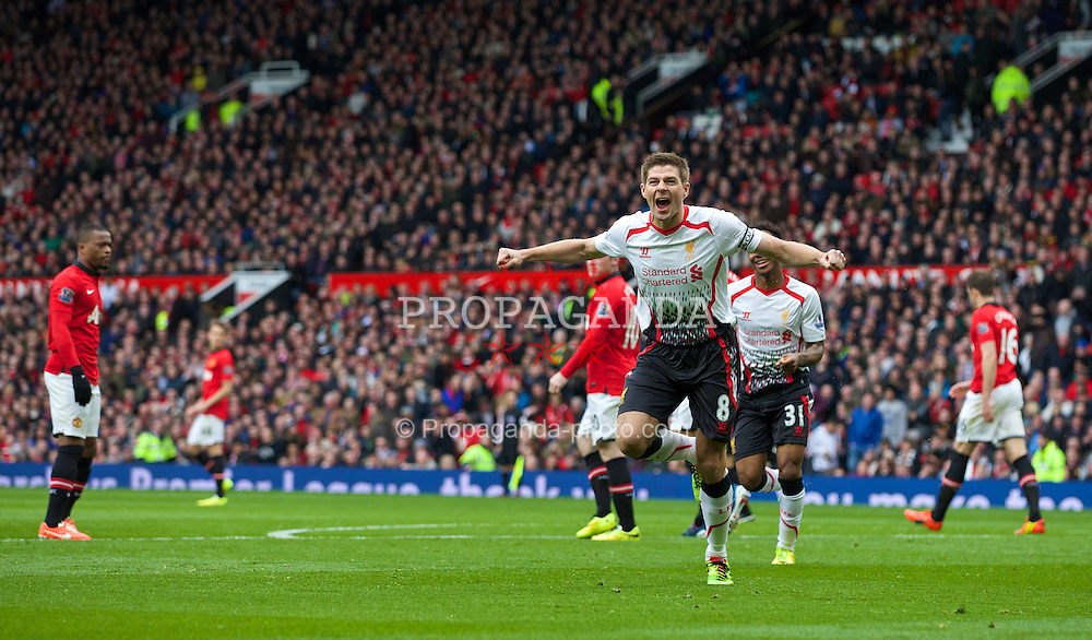 MANCHESTER, ENGLAND - Sunday, March 16, 2014: Liverpool's captain Steven Gerrard celebrates scoring the second goal against Manchester United from the penalty spot during the Premiership match at Old Trafford. (Pic by David Rawcliffe/Propaganda)