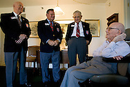 World War I Veteran Harry Landis, 107, at home in Sun City Center.  Landis is one of only four known surviving veterans of WWI.  Also pictured are three retired officers from the Military Officers Association of America, Lt. Col. Paul Wheat, Maj. Jerry Foppe and Cmdr. Ed Socha.