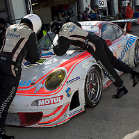 #76 Porsche 997 GT3 RSR in the pits - Imsa Performance Matmut (Drivers - Raymond Narac and Patrick Pilet) GT2, Le Mans Series Silverstone 1000KM 2010