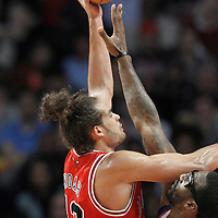 12 March 2012: Chicago Bulls center Joakim Noah (13) goes for the skyhook over New York Knicks power forward Amare Stoudemire (1) during the Chicago Bulls 104-99 victory over the New York Knicks at the United Center, Chicago, Illinois, USA.