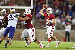 September 26, 2009; Stanford, CA, USA; Stanford Cardinal quarterback Andrew Luck (12) passes the ball in front of a block by guard David DeCastro (center) against the Washington Huskies during the second quarter at Stanford Stadium. Stanford defeated Washington 34-14. Mandatory Credit: Jason O. Watson-US PRESSWIRE