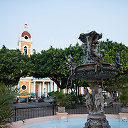 A fountain that stands in the center of Parque Central. Parque Central is the main square and the historic heart of Granada, Nicaragua.