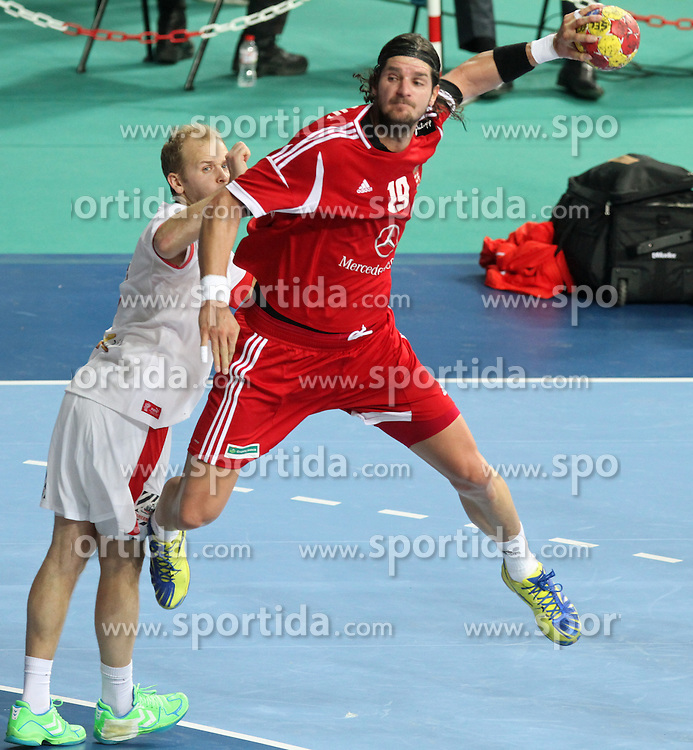 12.01.2013 Barcelona, Spain. IHF men's world championship, Quarter-Final. Picture show Laszlo Nagy    in action during game between Denmark vs Hungary at Palau ST Jordi (Photo by Sportida Photo Agency)