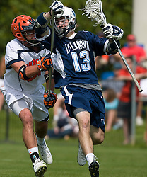 Villanova Wildcats Attack Mike Brennan (13) is defended by Virginia Cavaliers D Ryan Nizolek (24).  The #5 ranked Virginia Cavaliers defeated the #19 ranked Villanova Wildcats 18-6 in the first round of the 2008 NCAA Men's Lacrosse Tournament the University of Virginia's Klockner Stadium in Charlottesville, VA on May 10, 2009.
