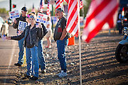 30 MAY 2011 - PHOENIX, AZ:  BILLIE MUSSELMAN, a member of Riders USA, honors American veterans before Memorial Day services in the National Memorial Cemetery in Phoenix, AZ, Monday. Memorial Day was celebrated with services across the United States Monday.    Photo by Jack Kurtz
