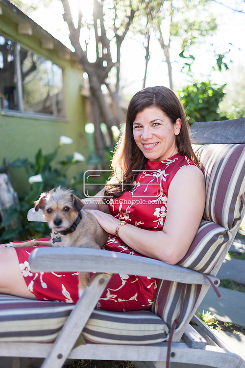 March 12, 2015. Los Angeles, California.  Author Robin Rinaldi, who has written a memoir &quot;The Wild Oats Project&quot; about how she spent a year in an open marriage, having sex with various different men, as a way of finding sexual fulfillment as a woman. Robin is pictured with her dog, Tengo.<br /> Photo Copyright John Chapple / www.JohnChapple.com /