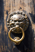 Lion-head knocker on door in the Yu Gardens, Shanghai, China