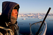 (MODEL RELEASED IMAGE). Emil Madsen is on the hunt for a seal just after midnight in Scoresby Sound, the enormous fjord on Greenland's eastern side. Later tonight he will find that seal and bring it back home for his wife, Erika, to clean and cook. (Supporting image from the project Hungry Planet: What the World Eats.)
