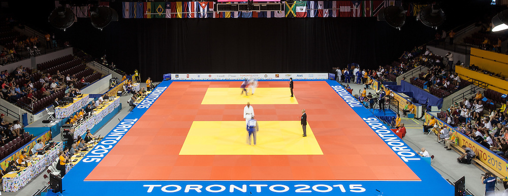 Competitors take part in the 14 finals on the final day of the judo competition at the 2015 Pan American Games in Toronto, Canada, July 14,  2015.  AFP PHOTO/GEOFF ROBINS