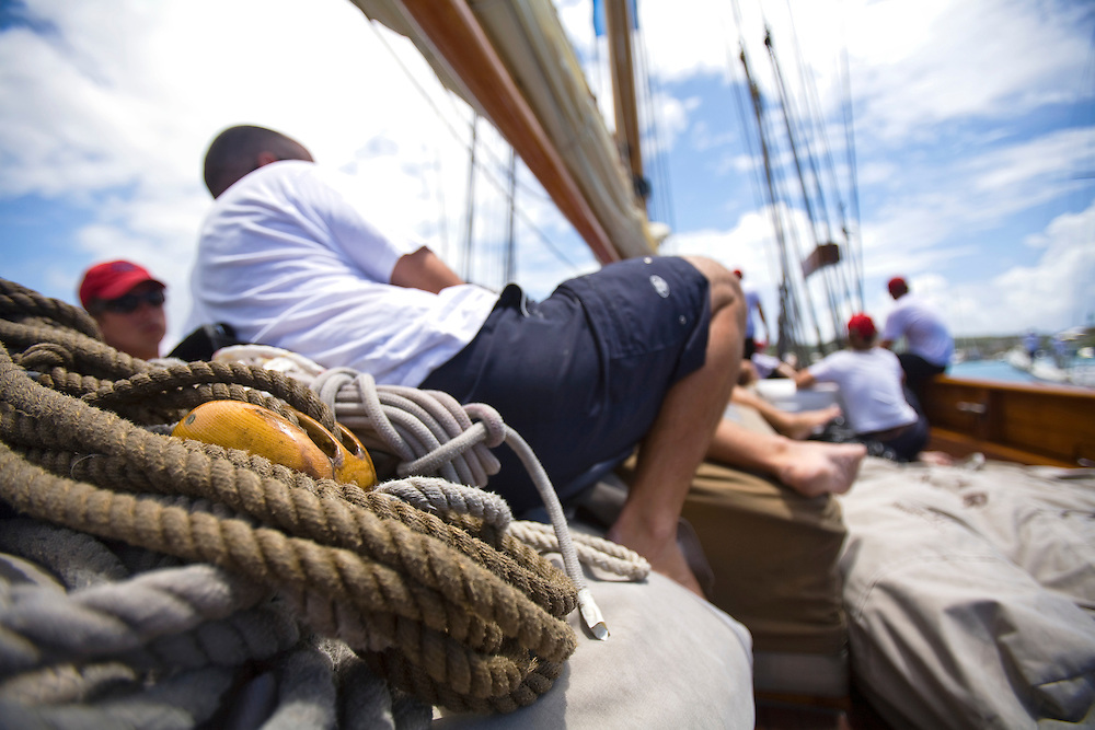 Crew members rest while waiting for the schooner yacht SY Altair dock at falmouth harbor marina  during the 2008 Antigua Classic Yacht Regatta . This race is one of the worlds most prestigious traditional yacht races. It takes place annually off the cost of Antigua in the British West Indies. Antigua is a yachting haven, historically a British navy base in the times of Nelson.