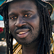 Smiling head and shoulders portrait of (Jamaican Rastafarian )African from the Islands  with dreadlocks.
