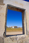 The officer's barracks through a window in the ruins of the administration building, Fort Laramie National Historic Site, Wyoming