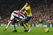 Leeds United midfielder Jack Harrison (22) takes on West Bromwich Albion defender Tosin Adarabioyo (24) on loan from Manchester City,  during the EFL Sky Bet Championship match between West Bromwich Albion and Leeds United at The Hawthorns, West Bromwich, England on 10 November 2018.