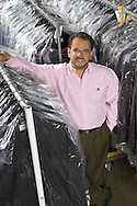 An executive portrait captured on location at a garment distribution center.
