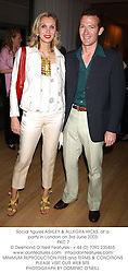 Social figures ASHLEY & ALLEGRA HICKS, at a party in London on 3rd June 2003.<br /> PKC 7