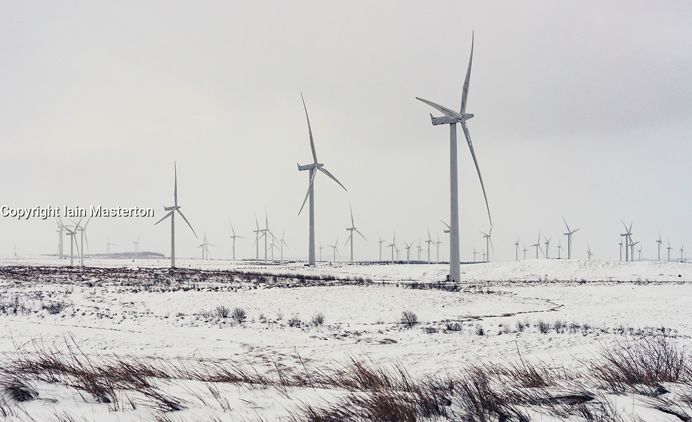 View of wind turbines at Whitelee Windfarm after snow fall in winter  operated by Scottish power, Scotland, United Kingdom